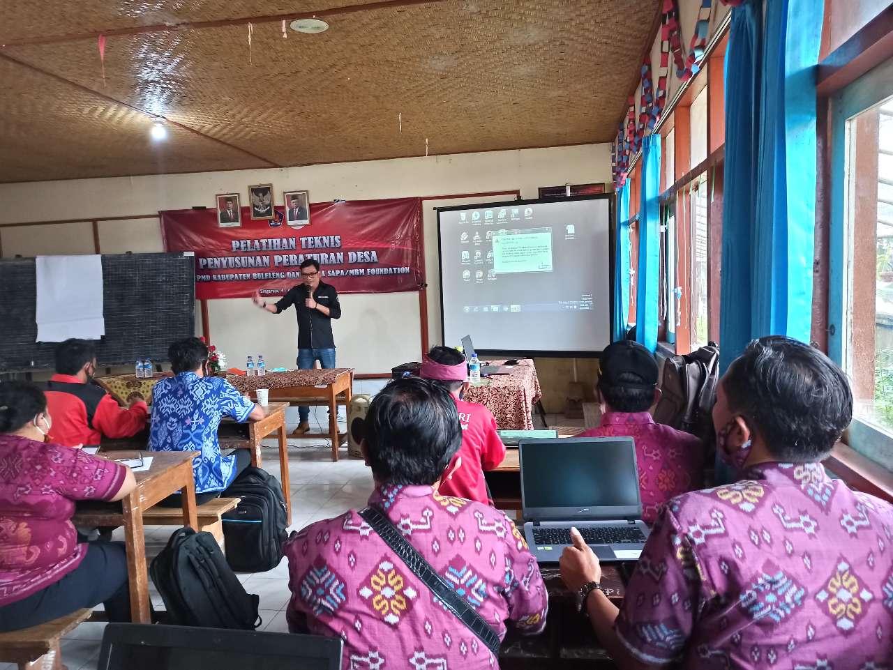 MBM bekerjasama dengan Dinas PMD Kabupaten Buleleng melakukan kegiatan Pelatihan Penyusunan Peraturan Desa bagi Pemerintah desa di Desa Wanagiri